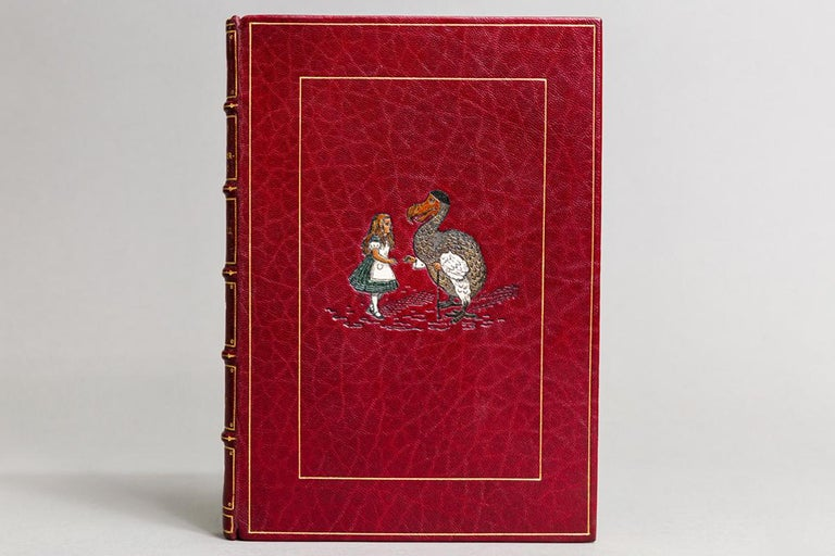 1 volume.   Illustrations by John Tenniel. Bound in full red Morocco with multi-colored onlay of Alice on front cover by Bayntun, top edges gilt, raised bands, gilt Panels, printed on handmade Riccardi Paper, limited to 1000 copies, This is