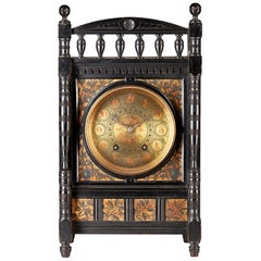Lewis F Day, Howell, James & Sons Aesthetic Movement Ebonised & Polychrome Clock