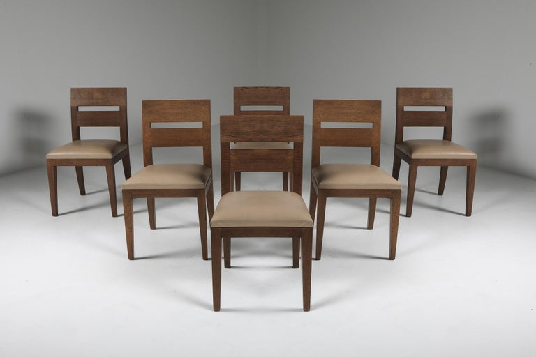 Christian Liaigre, dining chairs, solid oak, beige leather, France, 1999  Christian Liaigre was a French interior designer and architect. Born into a family from Vendée, Liaigre entered the École nationale supérieure des Beaux-Arts and the École