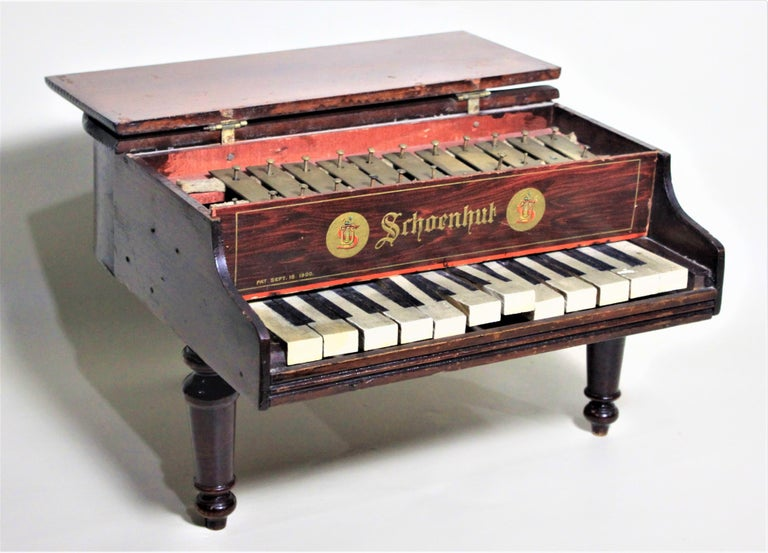 Made by the renowned American toy manufacturer in approximately 1920, this wooden toy baby grand piano has been autographed in two places by the legendary Liberace. The piano shows one signature on the bottom which is dated May 1954 or 1955 as the