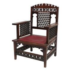 Liberty & Co a Moorish Walnut Armchair with Mashrabiya Turned Details Throughout