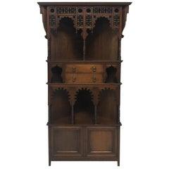 Liberty & Co. a Moorish Walnut Corner Cupboard with Musharabieh Turned Details