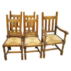 Liberty & Co. a Set of Six Arts & Crafts Oak Arrow Head Rush Seat Dining Chairs