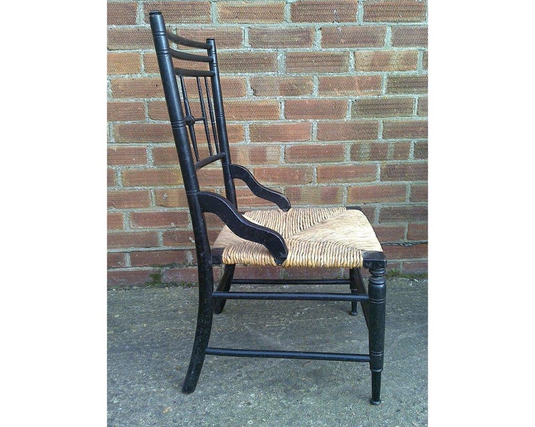 Liberty and Co. An aesthetic movement ebonized side chair from the Argyll suite designed in 1884, after a Sussex design by Ford Madox Brown for Morris and Co.