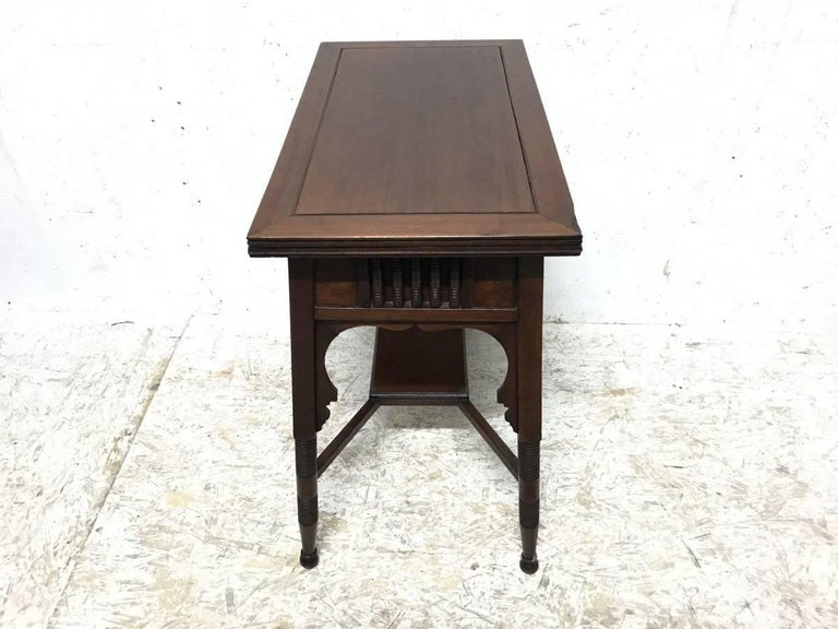 English Liberty & Co. an Anglo-Moorish Arts & Crafts Walnut Fold over Card & Games Table For Sale