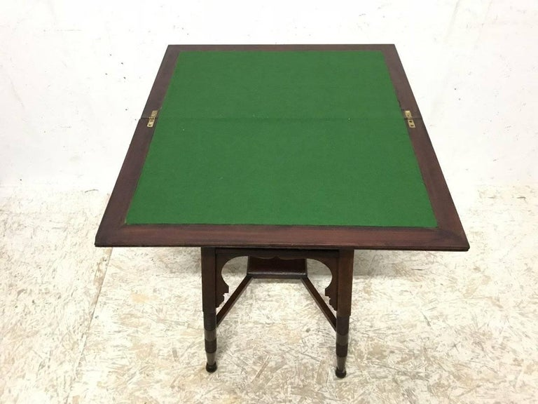 Liberty & Co. an Anglo-Moorish Arts & Crafts Walnut Fold over Card & Games Table In Good Condition For Sale In London, GB