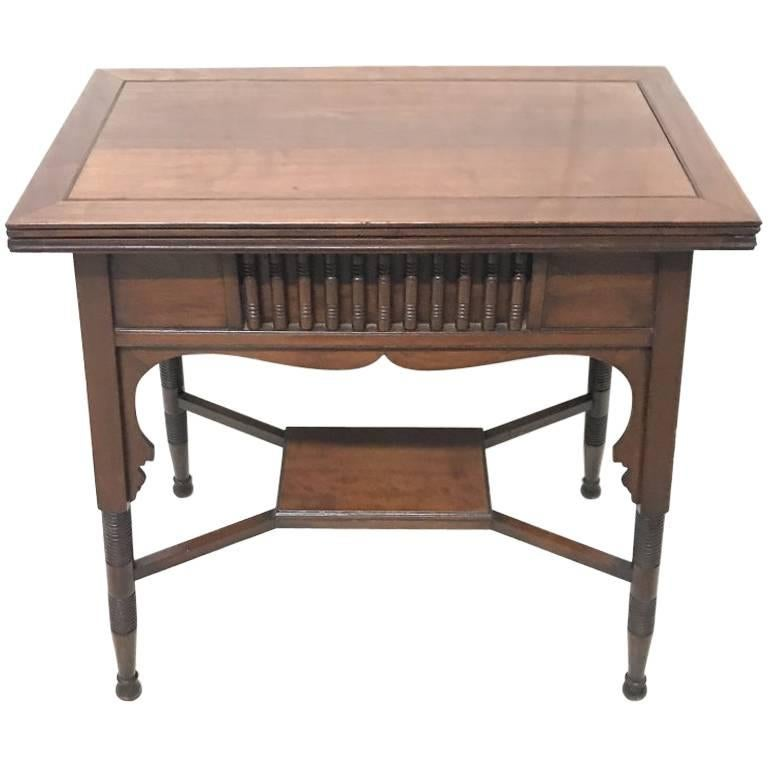 Liberty & Co. an Anglo-Moorish Arts & Crafts Walnut Fold over Card & Games Table For Sale