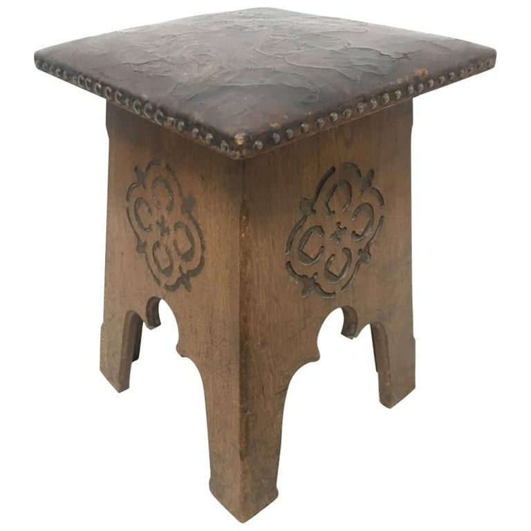 Liberty & Co, an Arts & Crafts Moorish Oak Stool with Embossed Leather Seat For Sale