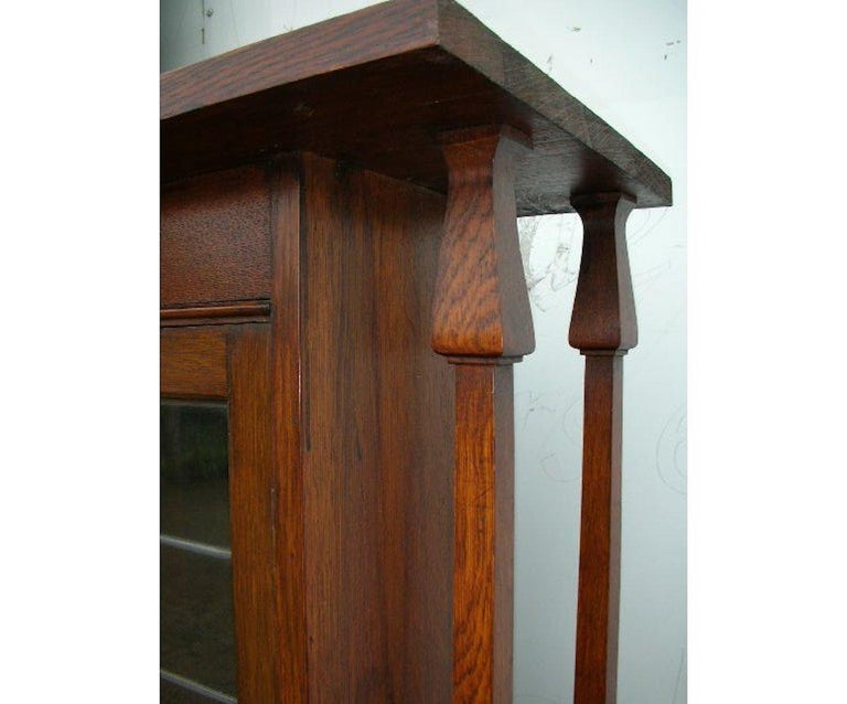 English Liberty & Co. an Arts & Crafts Oak Glazed Bookcase with Stylized Heart Details For Sale