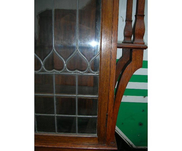 Hand-Crafted Liberty & Co. an Arts & Crafts Oak Glazed Bookcase with Stylized Heart Details For Sale