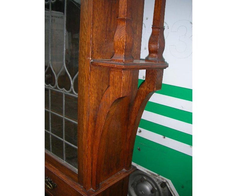 Liberty & Co. an Arts & Crafts Oak Glazed Bookcase with Stylized Heart Details In Good Condition For Sale In London, GB