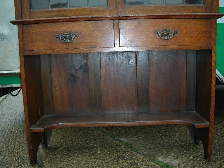 Glass Liberty & Co. an Arts & Crafts Oak Glazed Bookcase with Stylized Heart Details For Sale