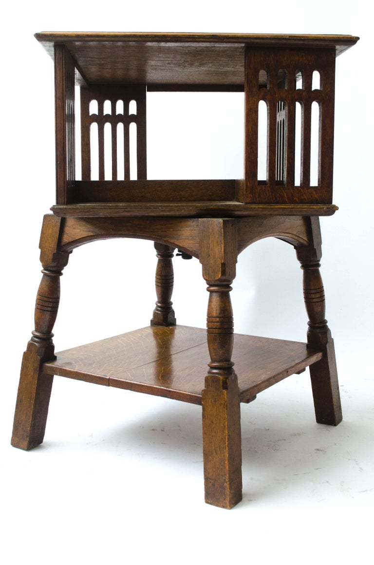 Arts and Crafts Liberty & Co an Arts & Crafts Oak Revolving Bookcase Table on Square Turned Legs For Sale