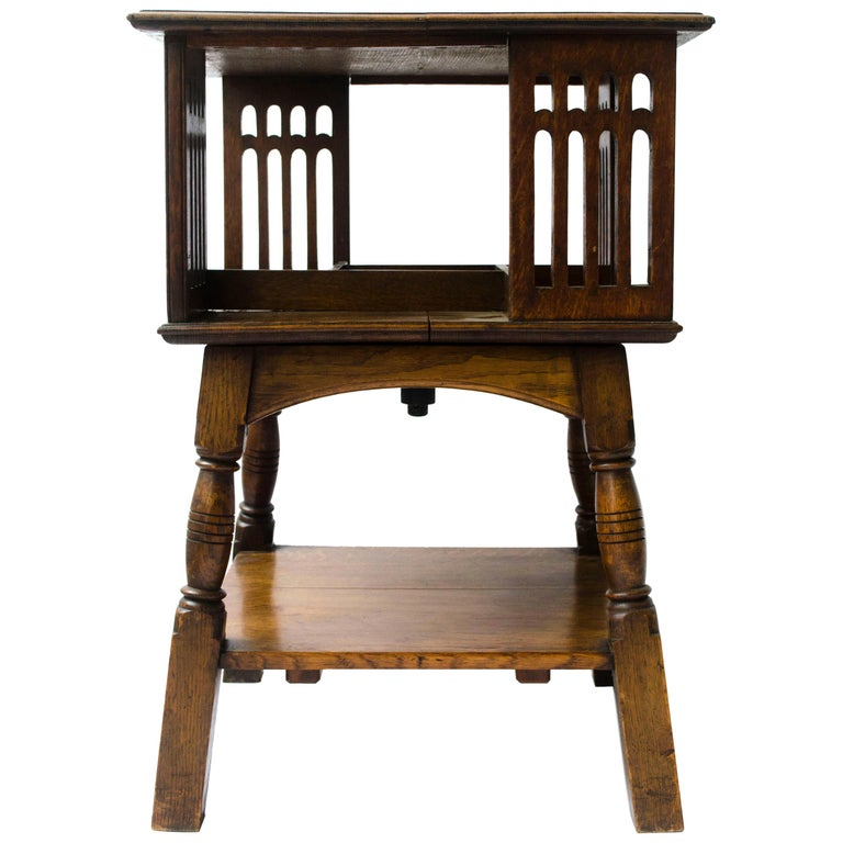 Liberty & Co an Arts & Crafts Oak Revolving Bookcase Table on Square Turned Legs For Sale