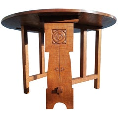 Liberty & Co, Arts & Crafts Oak Dropleaf Table with Stylized Carved Flower Head