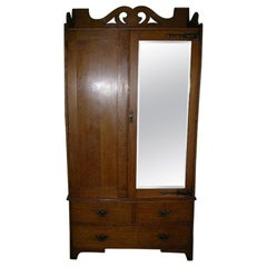 Liberty & Co. Attr Arts & Crafts Oak Double Wardrobe with Stylized Cut-Outs