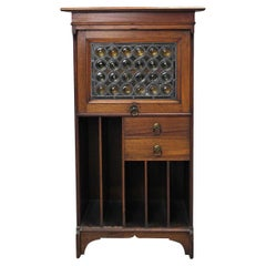 Liberty & Co Moorish Walnut Music Cabinet with Bottle Neck Glass Up & Over Door