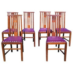 Liberty & Co Six Arts & Crafts Oak Dining Chairs with Stylized Floral Carving
