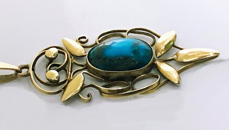 Rare Liberty Gold Turquoise Arts and Crafts Art Nouveau Pendant, William Haseler C.1910. Fully signed for W. H Haseler and 15ct for Liberty & Co; oval cabochon turquoise bezel set drop with polished foliate gold surround, together with 9ct gold