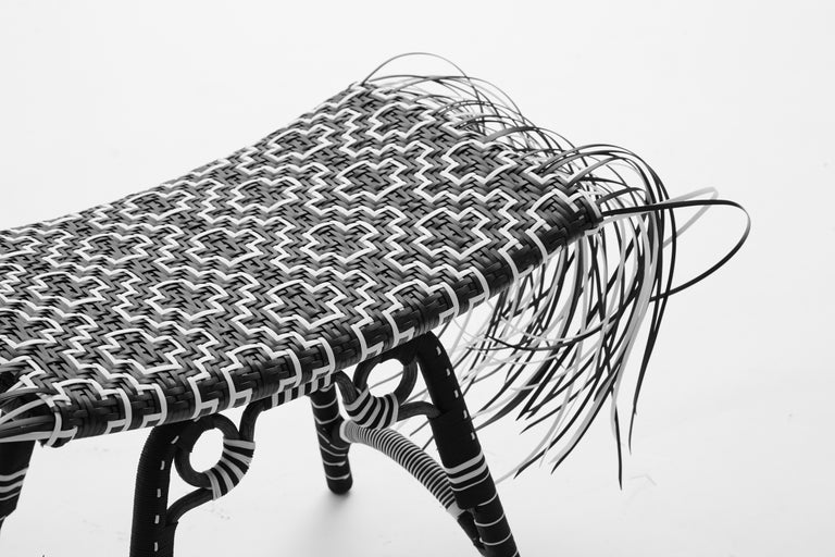 Libra stool, tribal stool   Inspired by the African Ashanti stool, the Libra has been re-contextualized with modern materials such as steel and recycled plastic strips. Kitt.Ta.Khon melds African references with Southeast Asian wicker techniques