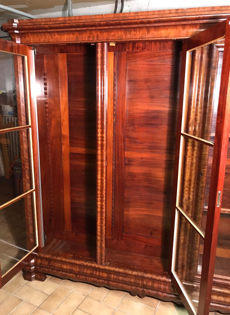 Library cabinet, Napoleon III, France second half of the 19th century, walnut and mahogany veneer, I good condition. Three doors with 6 shelves (mahogany veneer). The cabinet will be shipped from Germany. Shipping costs to Boston are included. It