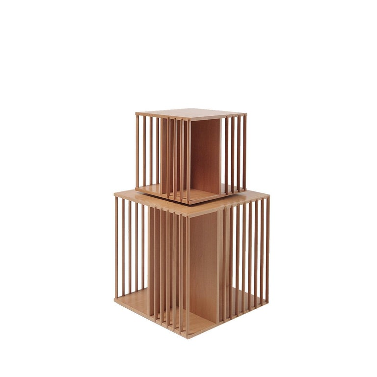 Designed by Cini Boeri for Bottega Ghianda, this revolving bookcase is meant to rest on a table, console, or desk and will be a sophisticated display case in any decor. The cube-shaped silhouette rotates on a wooden disk and is finished in pear wood