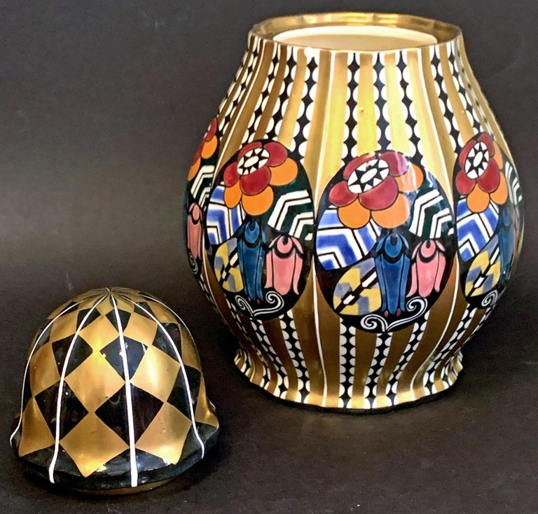 Spectacularly designed and executed, this rare ceramic lidded urn or vase enriched with a complex interplay of geometric and floral motifs was designed by Austrian architect Emanuel Josef Margold for the famed Wahliss Serapis ceramics line. The rich