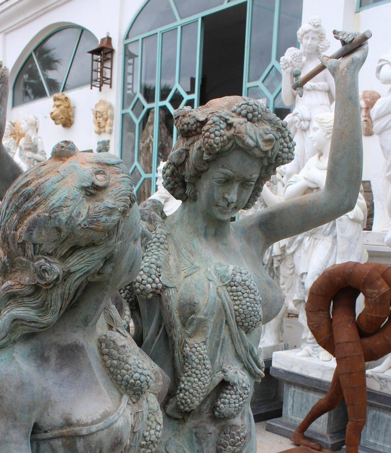 Spanish Life-Size Bronze Sculptures of Two Ladies and a Cherub For Sale