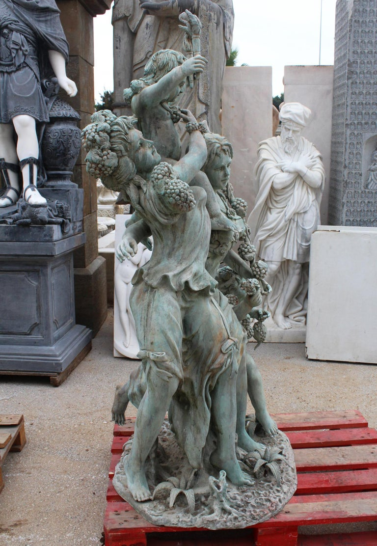 Life-size bronze sculptures of two ladies with cherubs, where the bottom one is holding grapes, a symbol for autumn that dominates the piece along with vegetative motifs. The top cherub is holding a pair of torches, that usually represent the cold