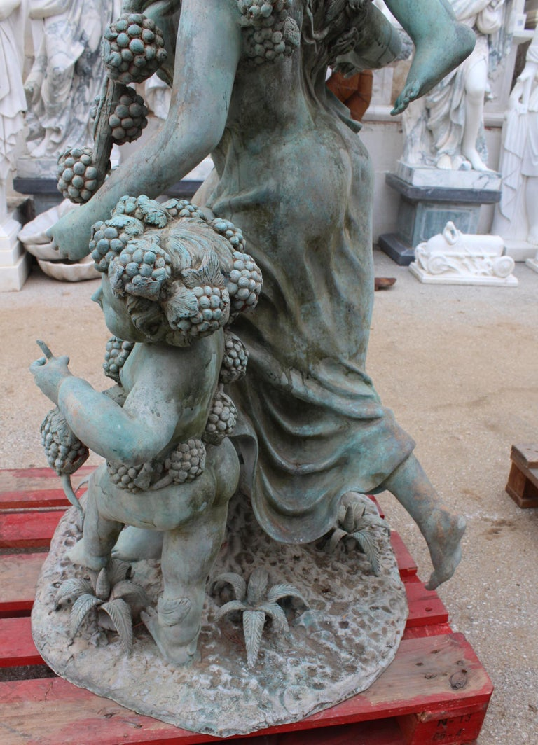 Life-Size Bronze Sculptures of Two Ladies with Cherubs For Sale 3