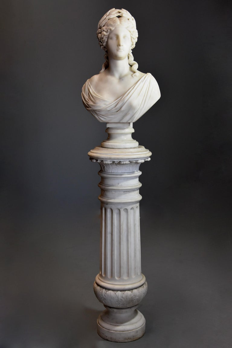 A 19th century life-size finely carved Carrara marble bust of the Roman Goddess, Ceres or her Greek equivalent, Demeter supported on original carved Carrara marble column in the classical style, signed 'S. KITSON, Fecit 18ROMA74' (fecit translating