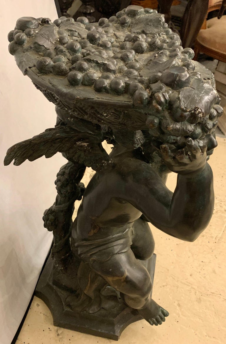 Life-Sized Bronze Cherub Kneeling Figure Holding Fruit Basket For Sale 7
