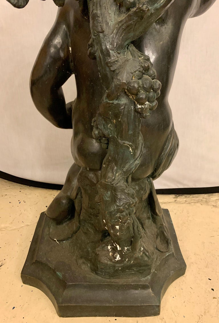 Life-Sized Bronze Cherub Kneeling Figure Holding Fruit Basket For Sale 12