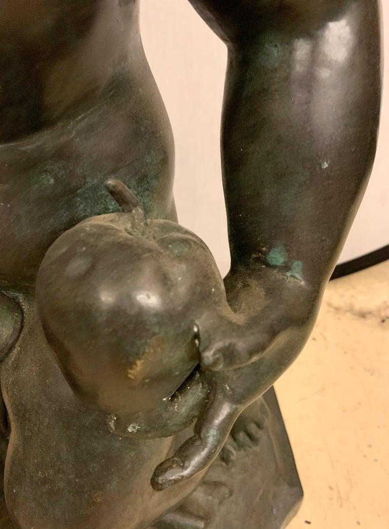 Life-Sized Bronze Cherub Kneeling Figure Holding Fruit Basket For Sale 2
