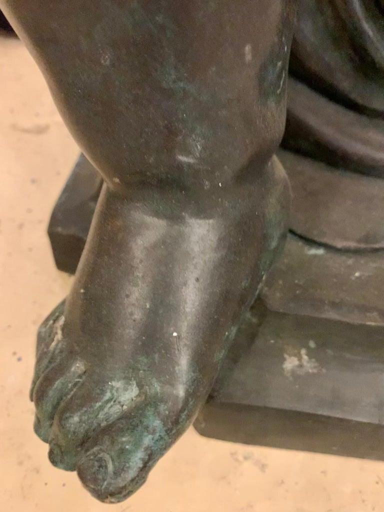 Life-Sized Bronze Cherub Kneeling Figure Holding Fruit Basket For Sale 3