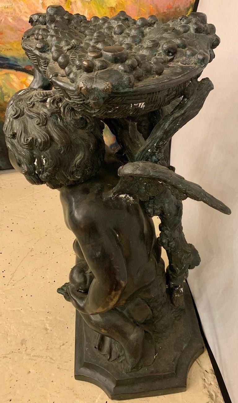 Life-Sized Bronze Cherub Kneeling Figure Holding Fruit Basket For Sale 6