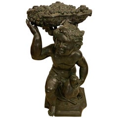 Life-Sized Bronze Cherub Kneeling Figure Holding Fruit Basket