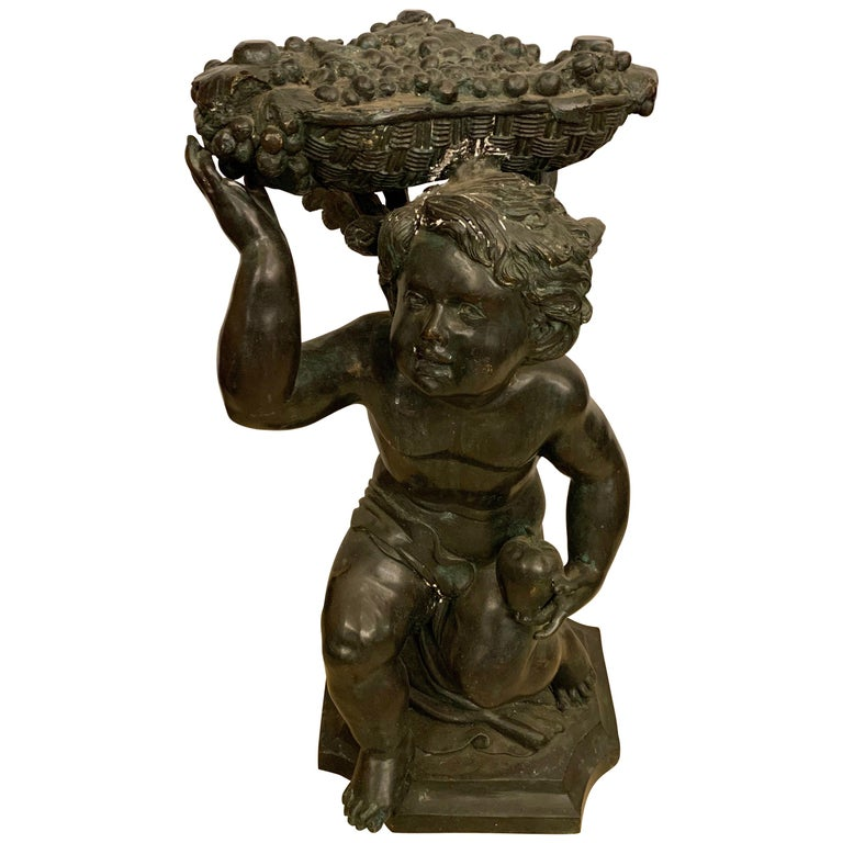 Life-Sized Bronze Cherub Kneeling Figure Holding Fruit Basket For Sale