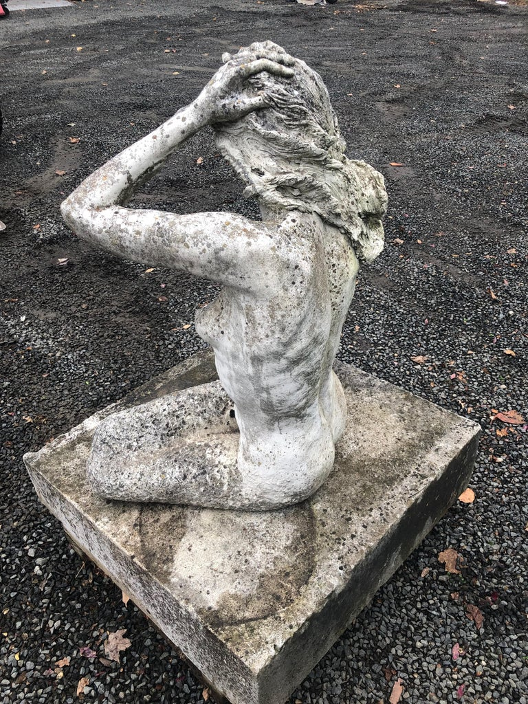 Life-Sized English Cast Stone Statue of a Mermaid Atop a Carved Stone Base In Good Condition For Sale In Woodbury, CT