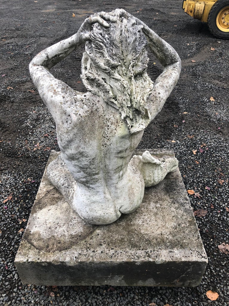 20th Century Life-Sized English Cast Stone Statue of a Mermaid Atop a Carved Stone Base For Sale