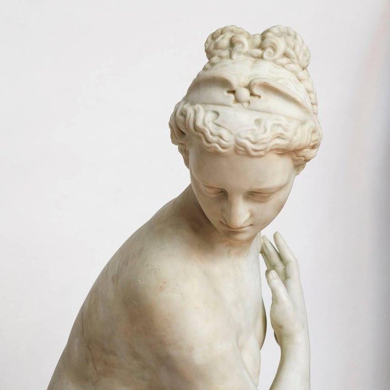 A Italian life size sculpture of Venus nude and in contemplation, probably after bathing, in white statuary marble, circa 1860-1880.