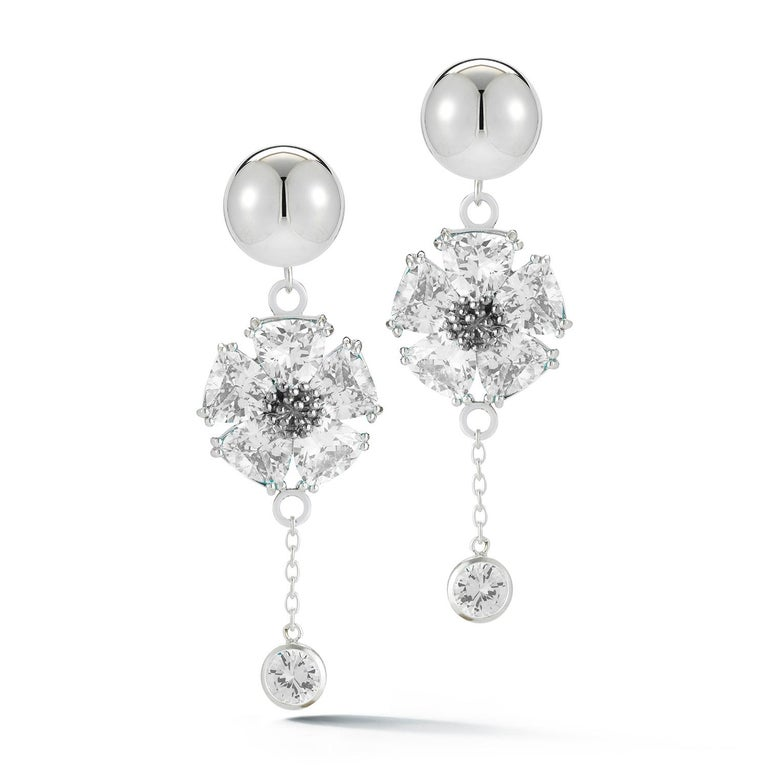 Designed in NYC  .925 Sterling Silver 2 x 20 mm Light Blue Sapphire Blossom Stone Bezel Earrings. Elegance of the blossom with stone meets a double round beauty stone bezel, for day or night.  Blossom stone bezel drop earrings:        Sterling