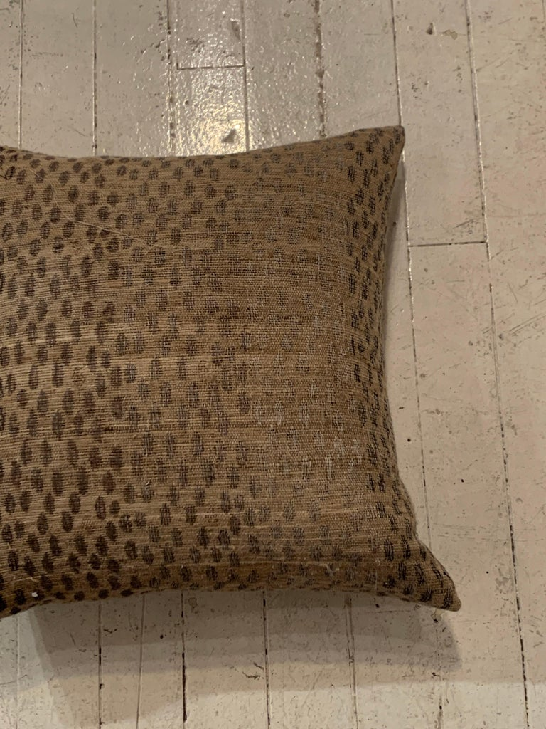 Light brown and dark brown animal print pattern Indonesian handspun woven fine linen pillow. Four very decorative patterns are available, pillows are sold individually. Each pillow has a down filled filter and zipper closure. See images #7