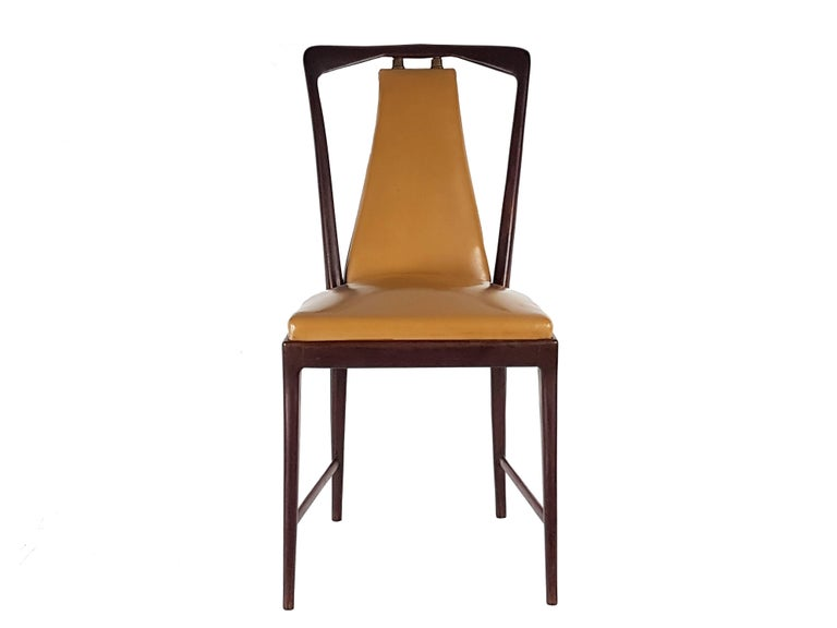 This set of six dining chairs was produced in Italy by Fossati, Attillio & Arturo from Varedo in the late 1940s. The chairs are made from dark-brown wooden structure with a light-brown skai seat and back. The set remains in very good vintage