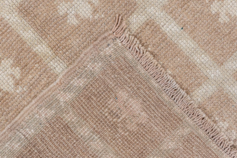A study in light brown and ecru, this Anatolian village piece shows a five column windowpane square pattern, no borders. Works anywhere: in a walk-in closet, a tiny hallway or as a discreet accent.