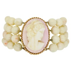 Light Pink Coral and Carved Cameo Bracelet with 14 Karat Gold Clasp
