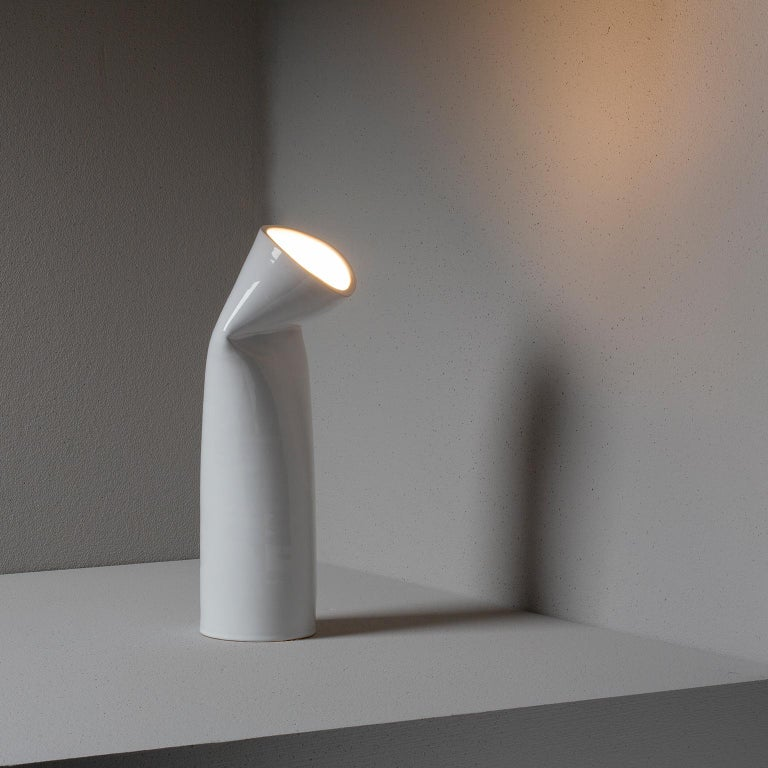 Ceramic table lamp, the bright vase handcrafted on a wheel and sculpted by hand. Furnishing accessory that highlights the plastic nature of the material set by the firing. It uses a simple 7v led light bulb.