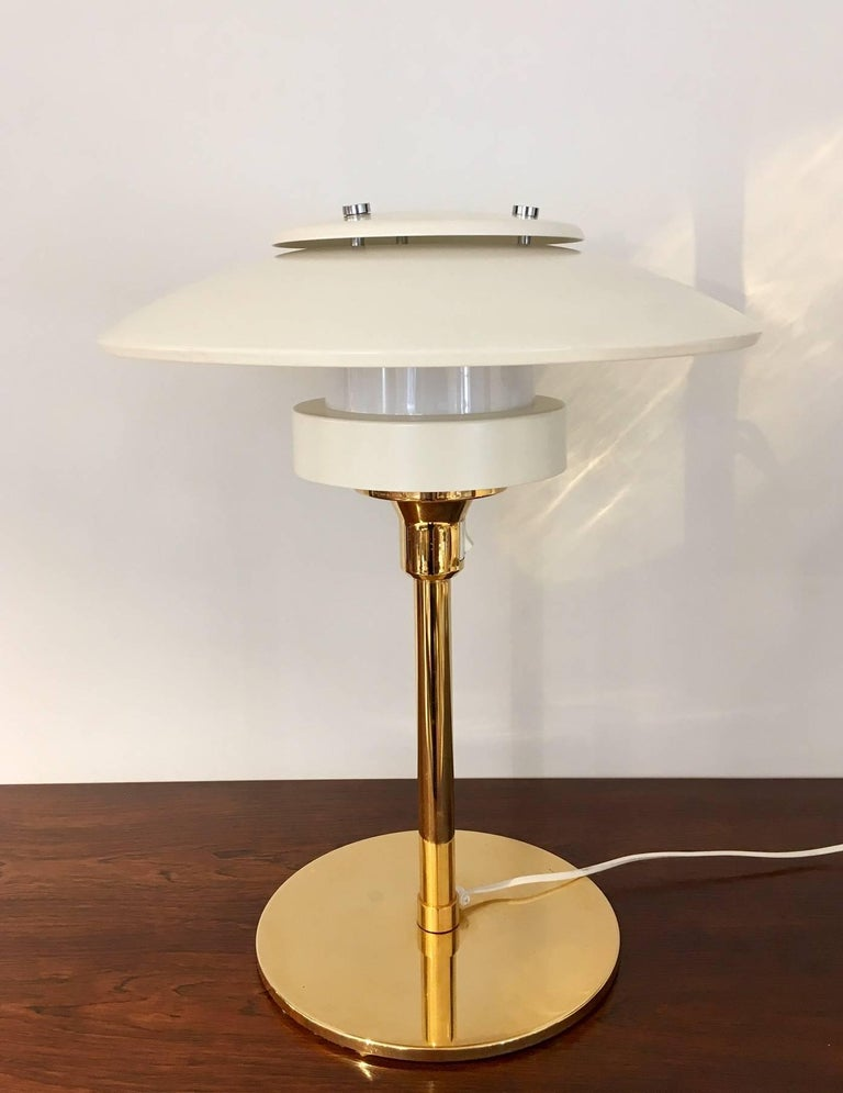 Danish table lamp, model 2686, from circa 1960s, produced by Light Studio by Horn. Brass rod and chrome-plated metal details, shade made of white painted metal. European plug.
