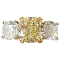 Light Yellow Diamond Three-Stone Platinum Ring