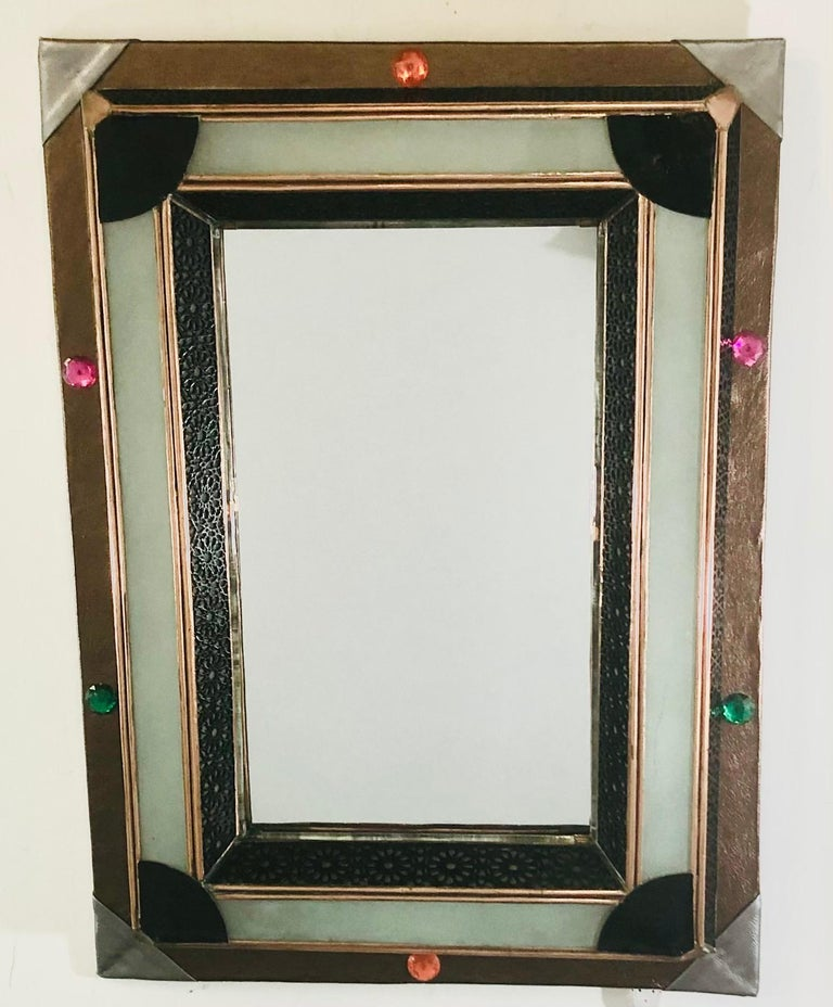 Lighted Art Deco Style Vanity Mirror or Wall Mirror A delightful vanity or wall mirror featuring multicolored buttons and a faux leather frame. The mirror has a lighted milk glass frame that is wired. The faux leather shows beautiful geometrical